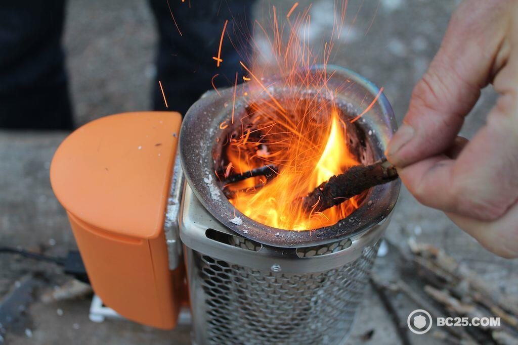 feeding biolite stove with small wood sticks