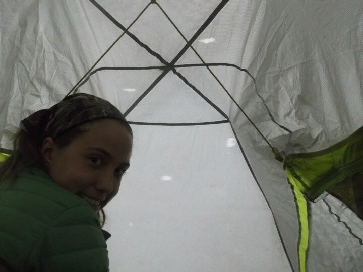 waiting out rain inside my tent