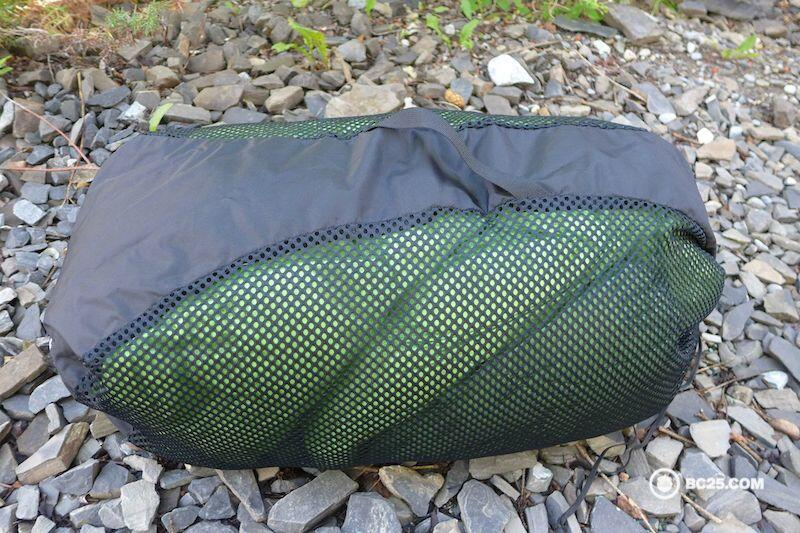 A Mountain Hardwear sleeping bag in it's mesh storage sack giving it plenty of room to expand.